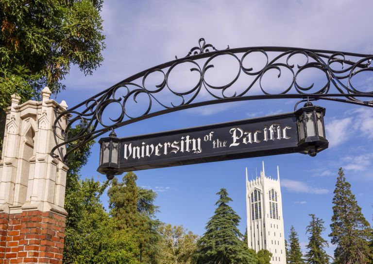 University of the Pacific sign with Burns Tower in the background