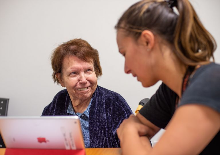 a community member works with a speech-language pathology student in a clinical setting