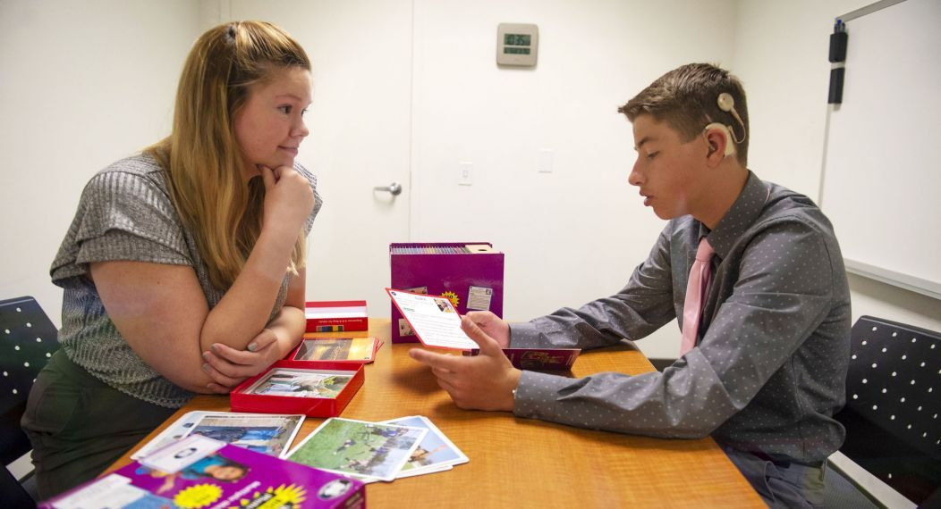 Speech-language pathology student Anna Thompson works with child client